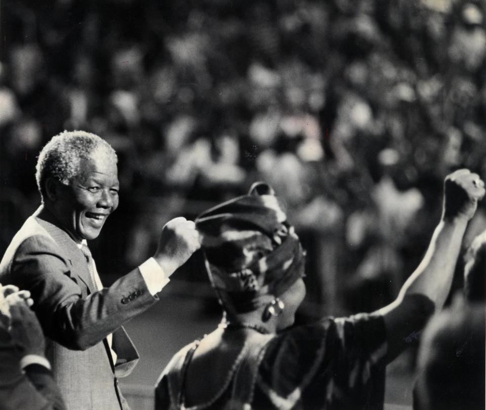 June 23, 1990: Nelson Mandela acknowledged the cheers after his speech at the Hatch Shell. His then-wife Winnie is at right. His remarks praised Boston and Massachusetts for their fight against apartheid.